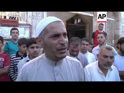 """Imam says joy of Eid has been lost to """"massacres, tanks and jets"""""""
