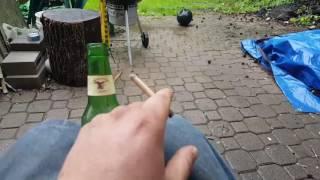Black cat bottle rocket set off from an actual bottle