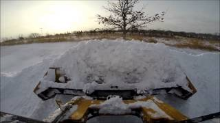 Plowing snow with a skid steer!! GoPro HD