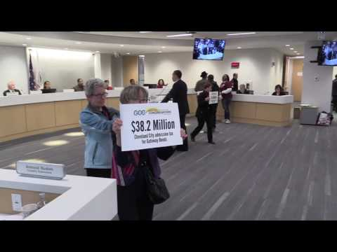 Protesters and supporters of Quicken Loans arena speak at Cuyahoga County Council chambers