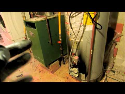 propane waterheater loaded with black soot