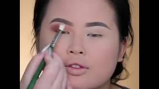 Nikki Tutorials Doing Makeup
