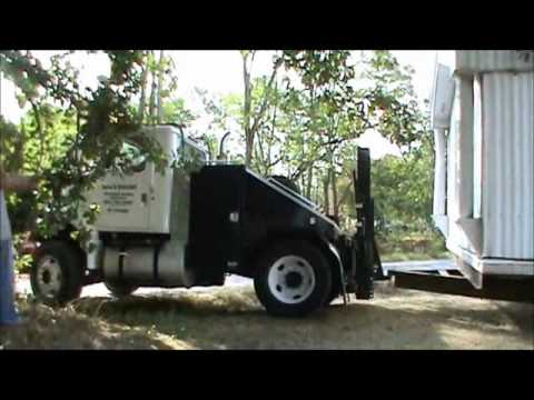 Moving a mobile home the hard way on mobile hmes for removable toter pulling, mobile home truck hitches, mobile home towing hitches, tractor hitches, toter truck hitches,