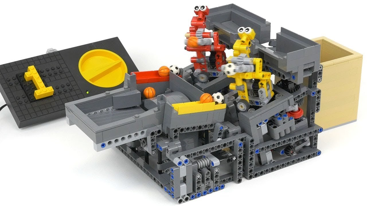 Watch Two Tiny LEGO Robots Working in a Ball Factory