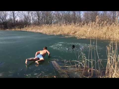 Drowning dog rescued from hole in thin ice!