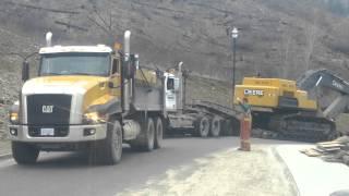 Dump truck pulls stuck Lowbed