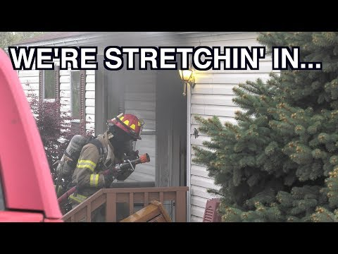 PRE-ARRIVAL: 1st due stretching in to a house fire