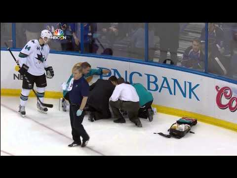 Dan Boyle taken off ice on stretcher after hit from Maxim Lapierre