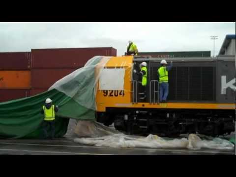 16 NEW KiwiRail Locomotives type DL unloaded, unwrapped and moved to Aucklands Port yard