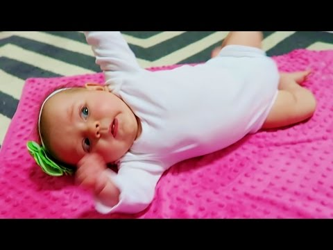 BABY ROLLS OVER FOR THE FIRST TIME! - YouTube
