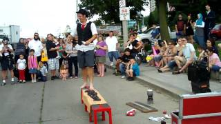 Busker Kobbler Jay Walking on Glass while Juggling Torches W