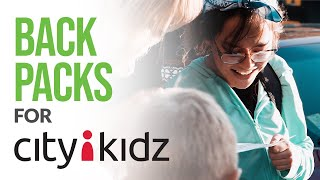 Giving Away Back Packs To City Kidz in Regina