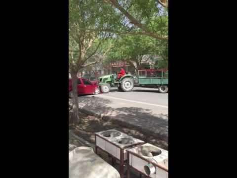 A man from Gansu, China driving a tractor crashed many cars crazily