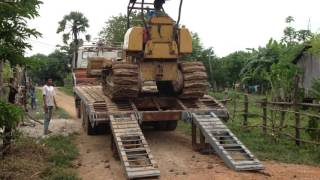 Bulldozer MITSUBISHI BD2F moves on truck trailer Kamaz បុលឡើងលើឡានដឹកម៉ាក Kamaz