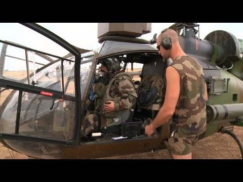 French helicopters return to base after Mali fight