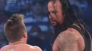 Undertaker clears the ring. 1/26/07 SD!
