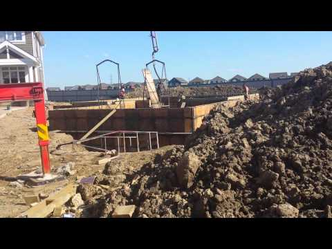 Pumping Concrete Truck Pour Cement into Basement