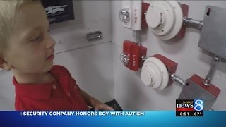 "Muskegon Boy named ""Honorary Alarm Technician"" for knowledge of fire alarms"