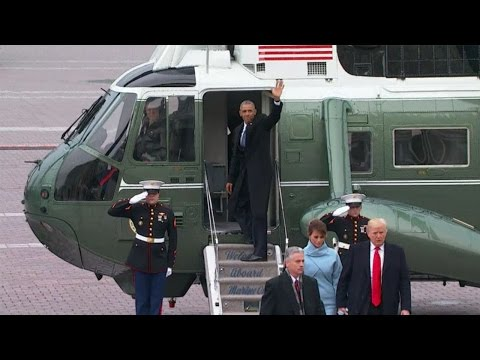 Barack Obama and wife Michelle depart Washington