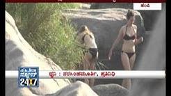 Hampi: Foreigners take bath in Virupaksha temple - Suvarnanews