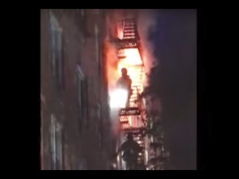 Firefighters scale flaming building in Staten Island