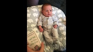 Daddy Andrew reading 3-day old Leah Julia Eil her first book