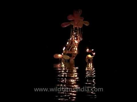 Pilgrims offering big lighted lamps to Pampa river at night