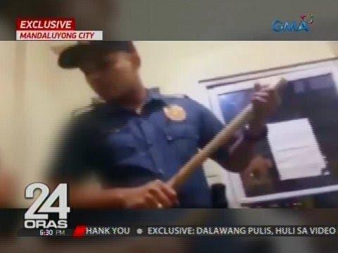 24 Oras Exclusive: Mga lumabag sa barangay ordinance, pinaghahampas at tinutukan ng baril ng 2 pulis