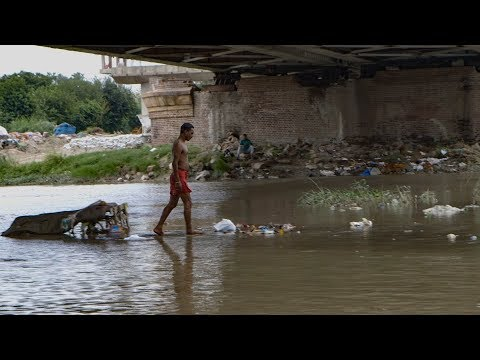 Diving for Coins in India's Most Polluted River