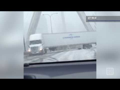 Raw video: Tractor trailer spins on slippery Zakim Bridge