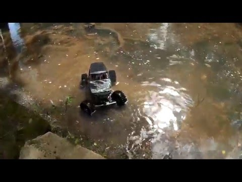 Does It Float?: Axial Wraith RC Rock Crawler Backflips Into Deep Water!