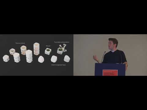 Robotic Assembly of Haptic Proxy Objects for Tangible Interaction and Virtual Reality