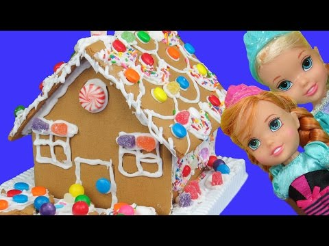 Thumbnail: Gingerbread house BUILDING ! ELSA, ANNA toddlers built it! Candies, royal icing and fun!