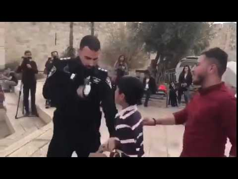 Israeli soldier confiscate the Palestinian scarf from Palestinian child