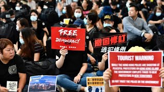 Thousands rally at Hong Kong airport to 'educate' visitors on alleged police violence