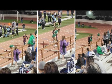Young Girls Helps Injured Opponent Across Finish Line