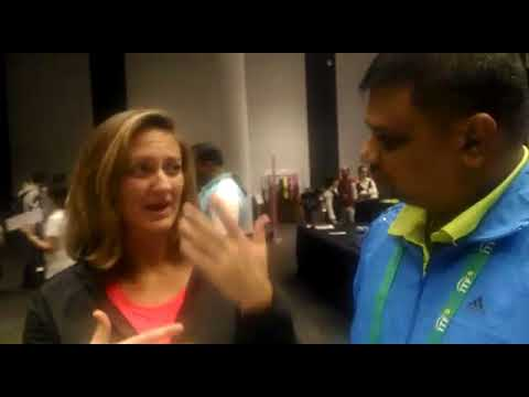 Grand Slam Champion Mary Pierce is talking with Ryder's Sports Academy's Head Tennis Coach