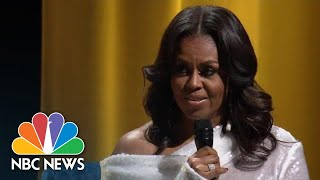 Former First Lady Michelle Obama kicked off her book tour with Oprah Winfrey in Chicago. » Subscribe to NBC News: http://nbcnews.to/SubscribeToNBC ...
