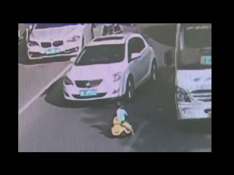 Toddler on Toy Car Rescued From Busy Roadway