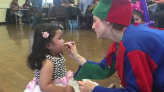 my sisters face getting painted  by a joker