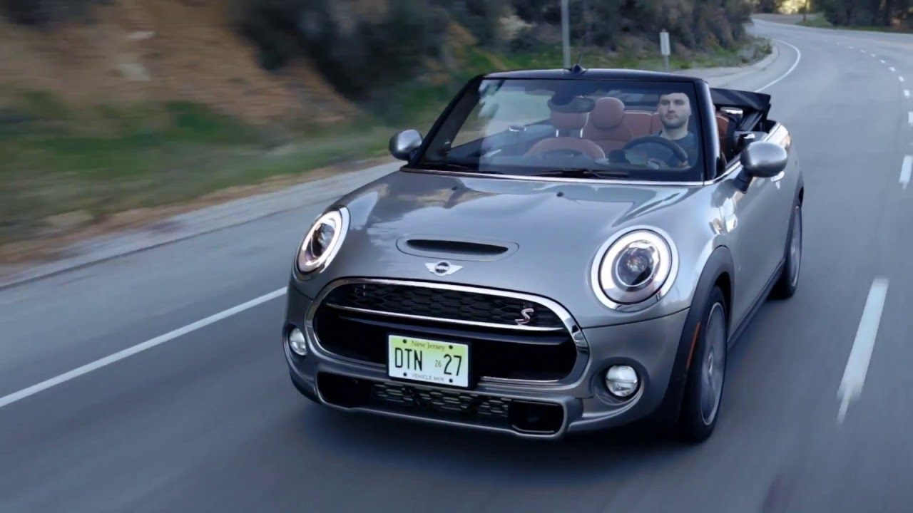 The New Mini Cooper S Convertible In Melting Silver Metallic Driving