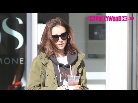 Lily Collins Protects The Paparazzi From Getting Hit By A Car While Leaving The Gym 11.29.16