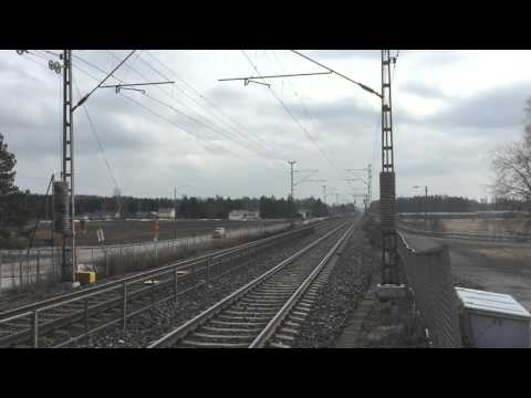 [VR] InterCity nr. IC175 (Hki → Tpe) pulled by class Sr2 electric locomotive passing Ainola.
