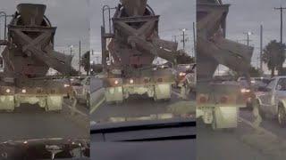 Video shows concrete mixer truck dumping massive amount of wet concrete on San Antonio road.