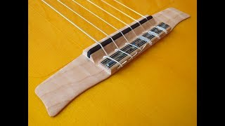 Surpassing obsolete features in nylon string guitars 8 (Extra flat maple bridge) Andalusian guitars