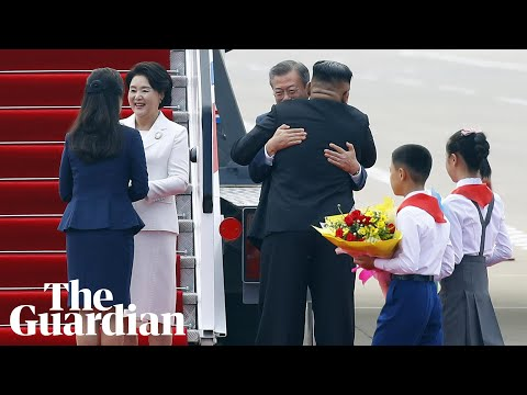 Wide smiles and big hugs: Kim Jong-un and Moon Jae-in kick off inter-Korean summit