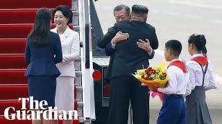Wide smiles and big hugs: Kim Jong-un and Moon Jae-in kick off inter-Korean summit