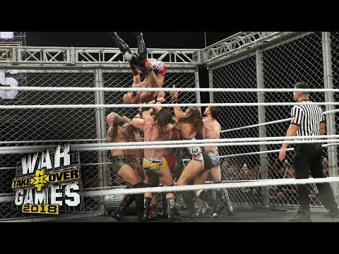 Ricochet performs a double Moonsault from the top of the WarGames Cage: NXT Takeover: WarGames II