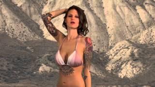 Marianna keeps dancing. Busty big boobs bikini dancer.