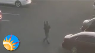 Eyewitness videos of Westgate shooting, one video shows armed suspect in the parking lot